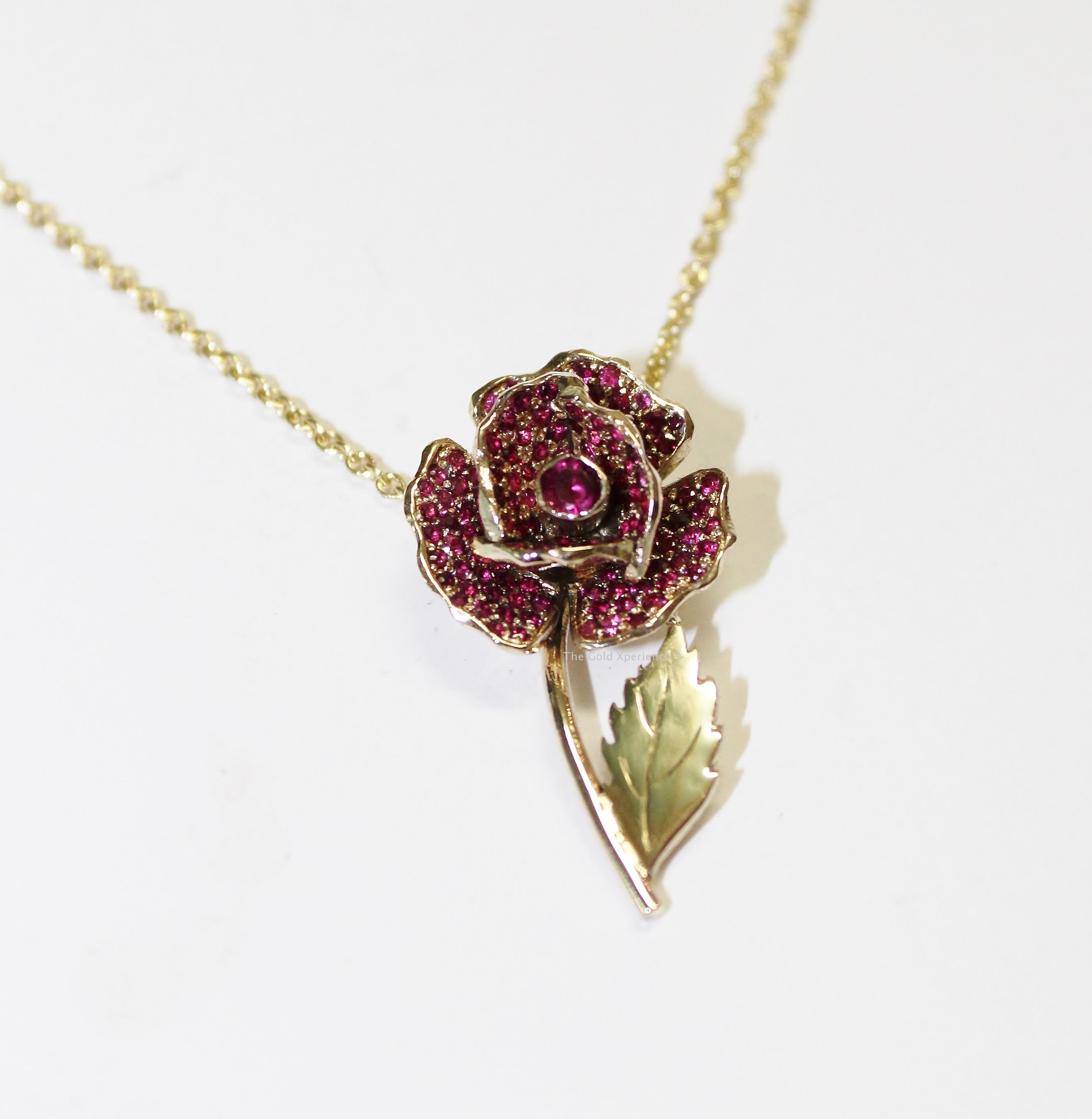 Gouden roosje met robijnen