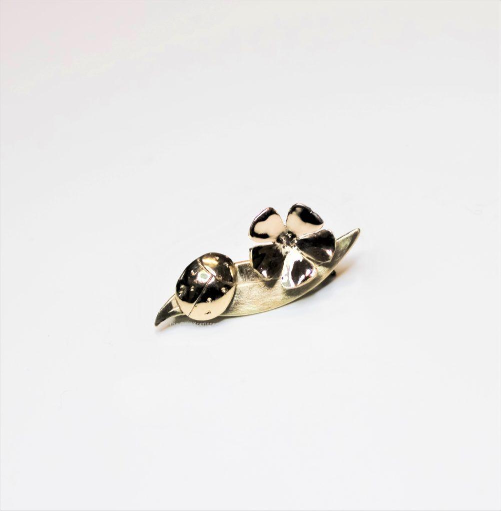 gouden broche lieveheersbeestje vergeet-me-nietje alzheimer